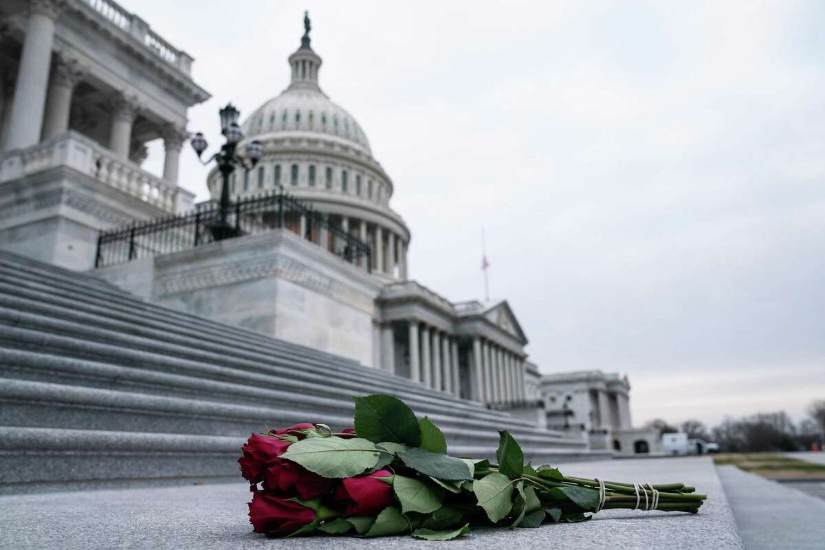 FILE -- A bouquet of roses sits on the steps up to the House side of the Capitol in Washington, Jan. 8, 2021. At least three investigations into the security response on January 6 are underway. (Anna Moneymaker/The New York Times)
