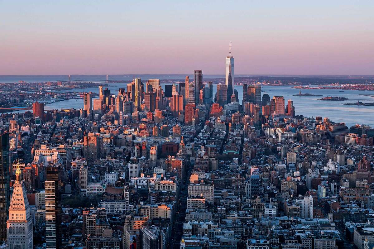 The Manhattan skyline is seen at sunrise from the 86th floor observatory of the Empire State Building on April 3, 2021.