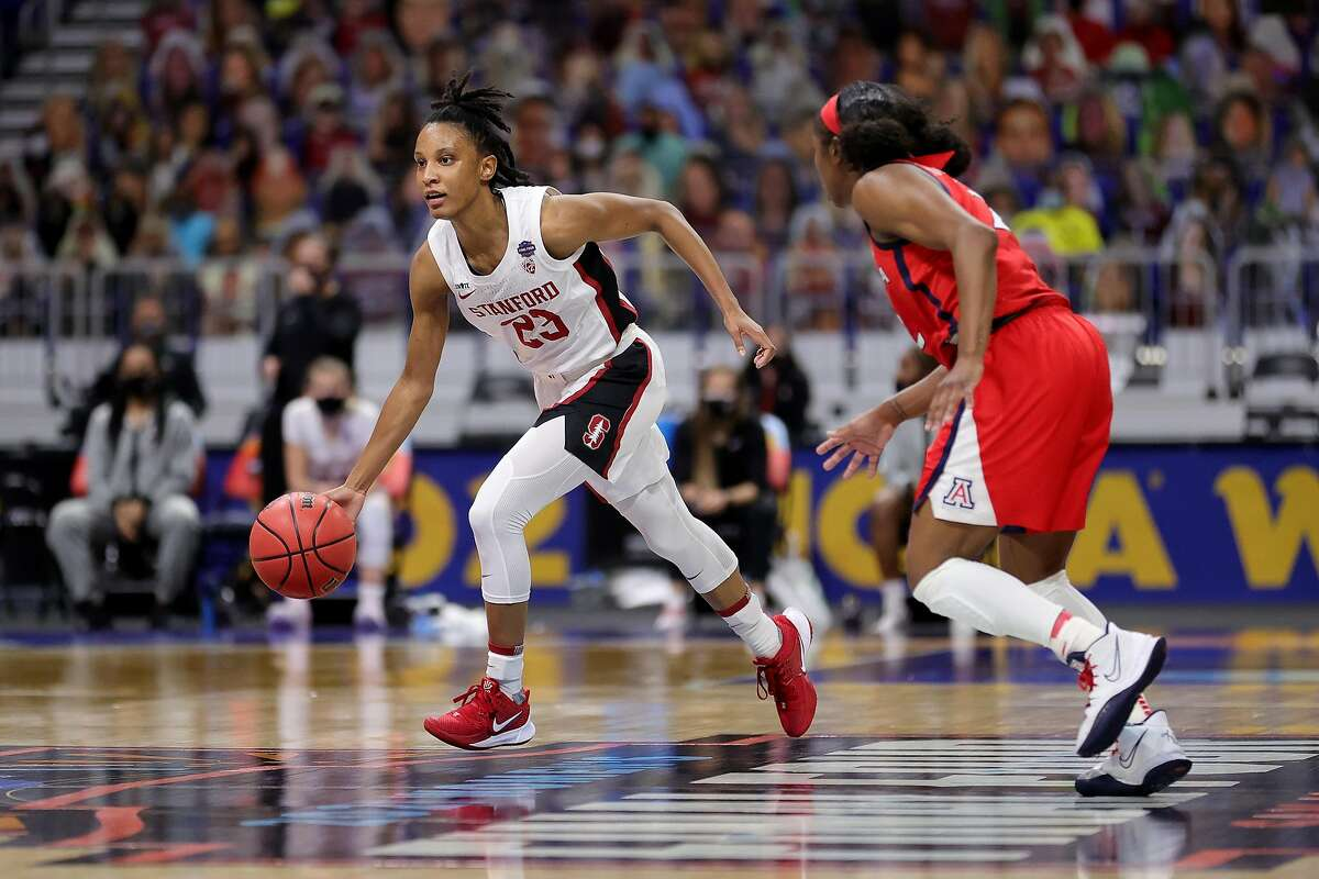 SAN ANTONIO, TEXAS - APRIL 04: Kiana Williams brings the ball up court against Aari McDonald #2 of the Arizona Wildcats in the National Championship game of the 2021 NCAA Women's Basketball Tournament at the Alamodome on April 04, 2021 in San Antonio, Texas. (Photo by Carmen Mandato/Getty Images)