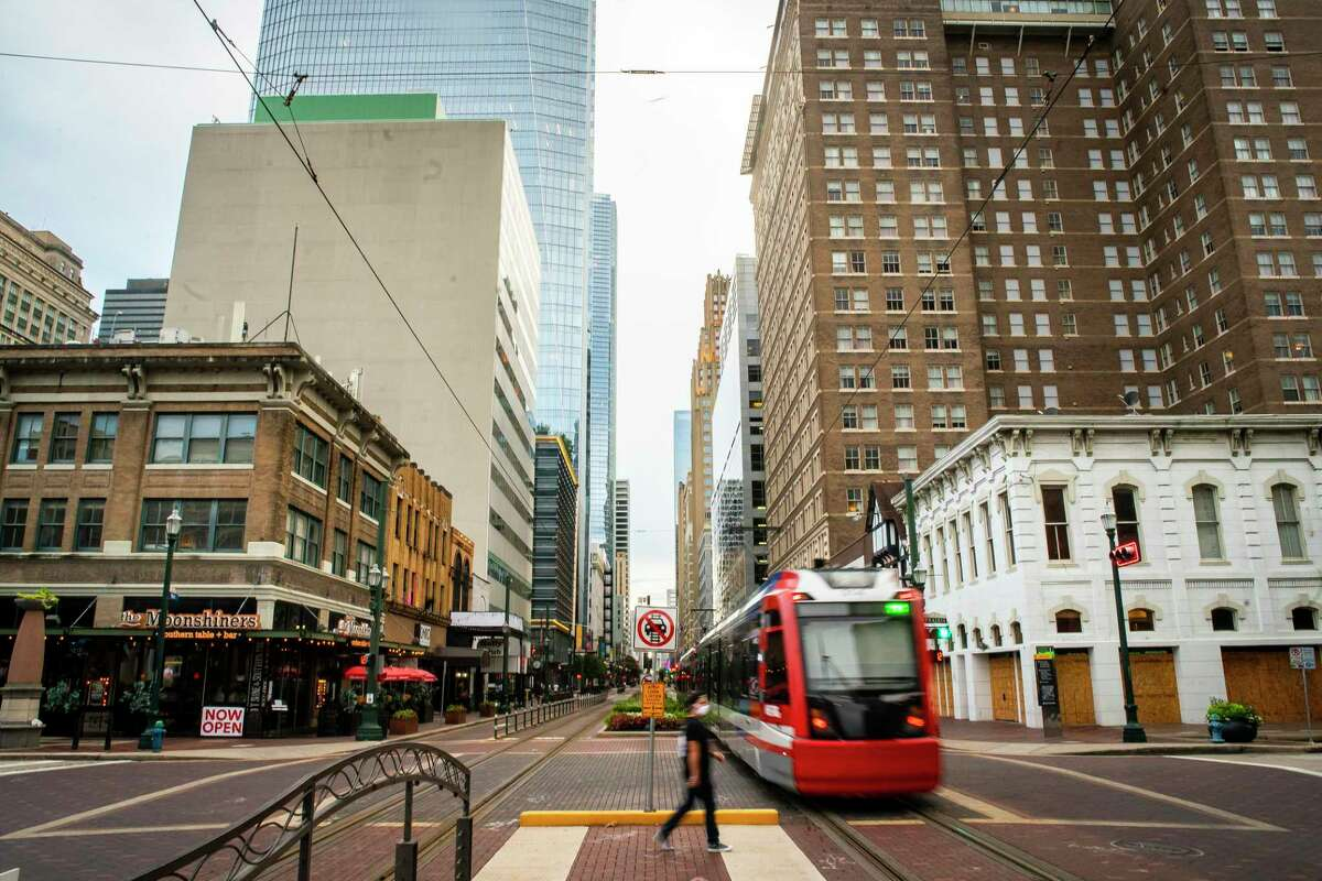 A Metro light rail train travels along Main Street, Tuesday, July 28, 2020, in downtown Houston.