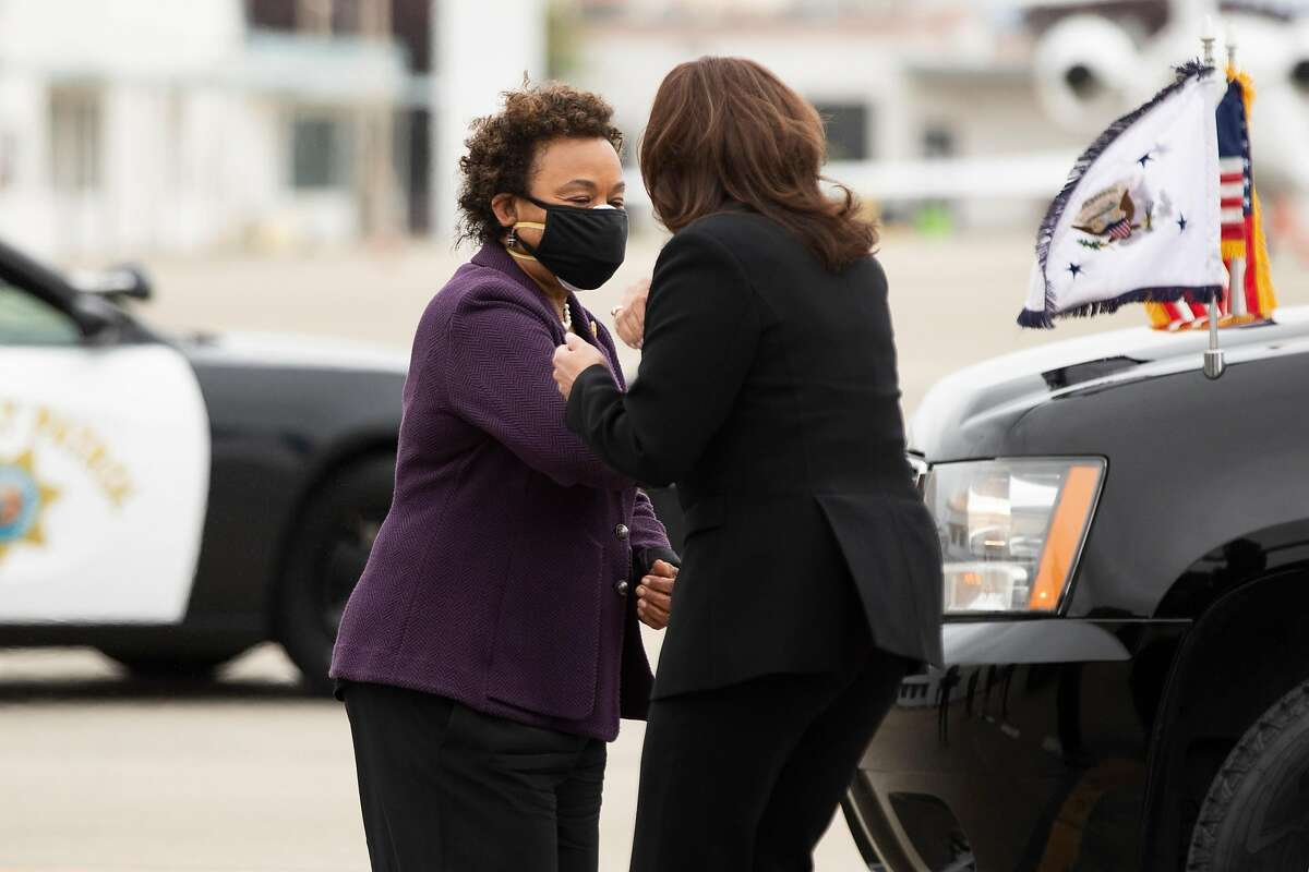 Vice President Kamala Harris elbow bumps Congresswoman Barbara Lee as she arrives on Air Force 2 to Oakland International Airport's Executive Terminal ahead of a day of scheduled events with local officials in Oakland, Calif. Monday, April 5, 2021.