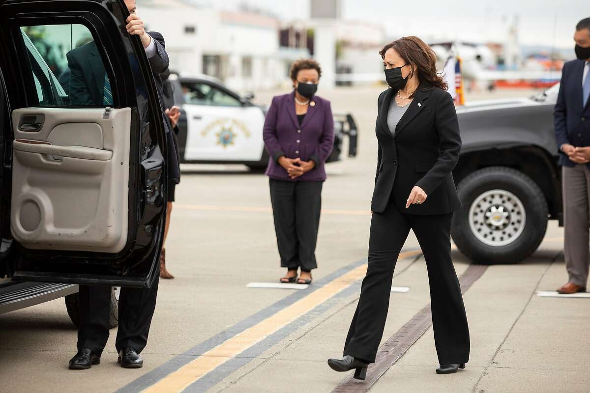 Vice President Kamala Harris enters an SUV after arriving on Air Force 2 to Oakland International Airport's Executive Terminal ahead of a day of scheduled events with local officials in Oakland, Calif. Monday, April 5, 2021.
