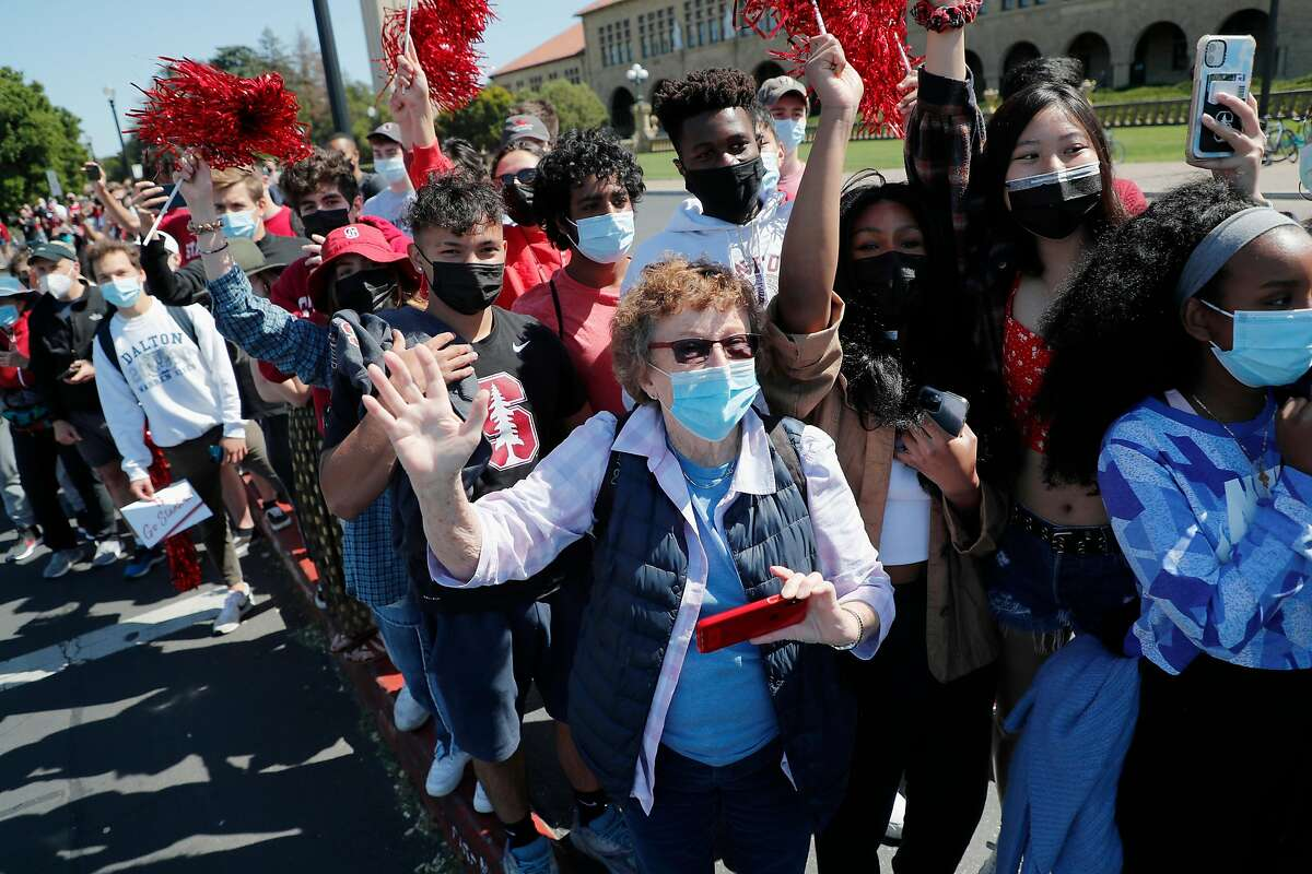 """A couple hundred students and fans gathered in """"The Oval"""" near the heart of Stanford's campus to cheer on the victors."""