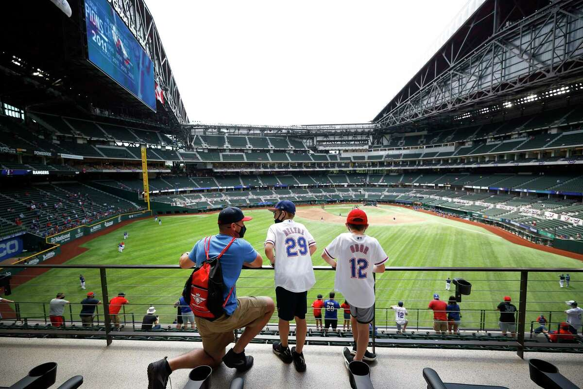 Fans look on during batting practice before the Texas Rangers take on the Toronto Blue Jays in the Rangers home opener at Globe Life Field in Arlington, on Modnay.