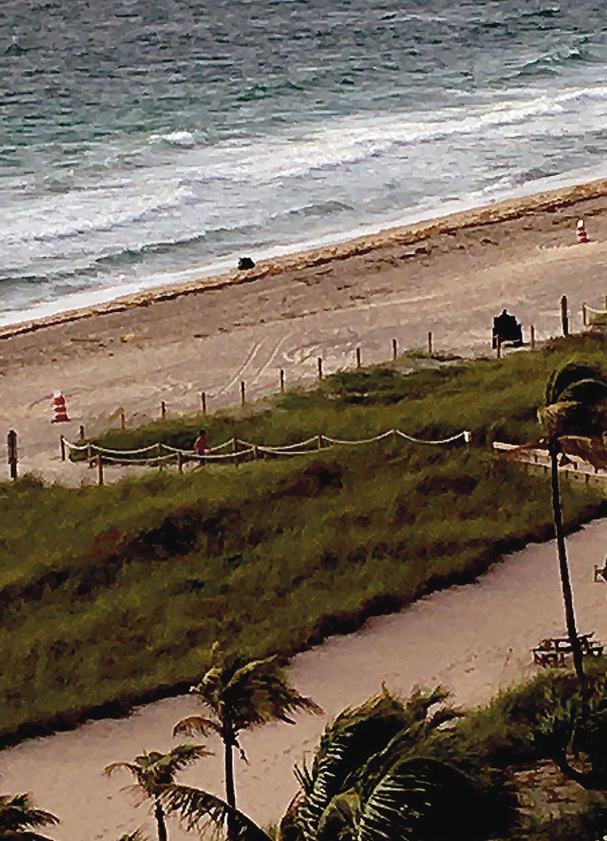 A naval mine washed up on the beach Sunday in Lauderdale-By-The-Sea, Florida, just outside the condo where Bev and Lonnie Johns of Jacksonville are wintering.