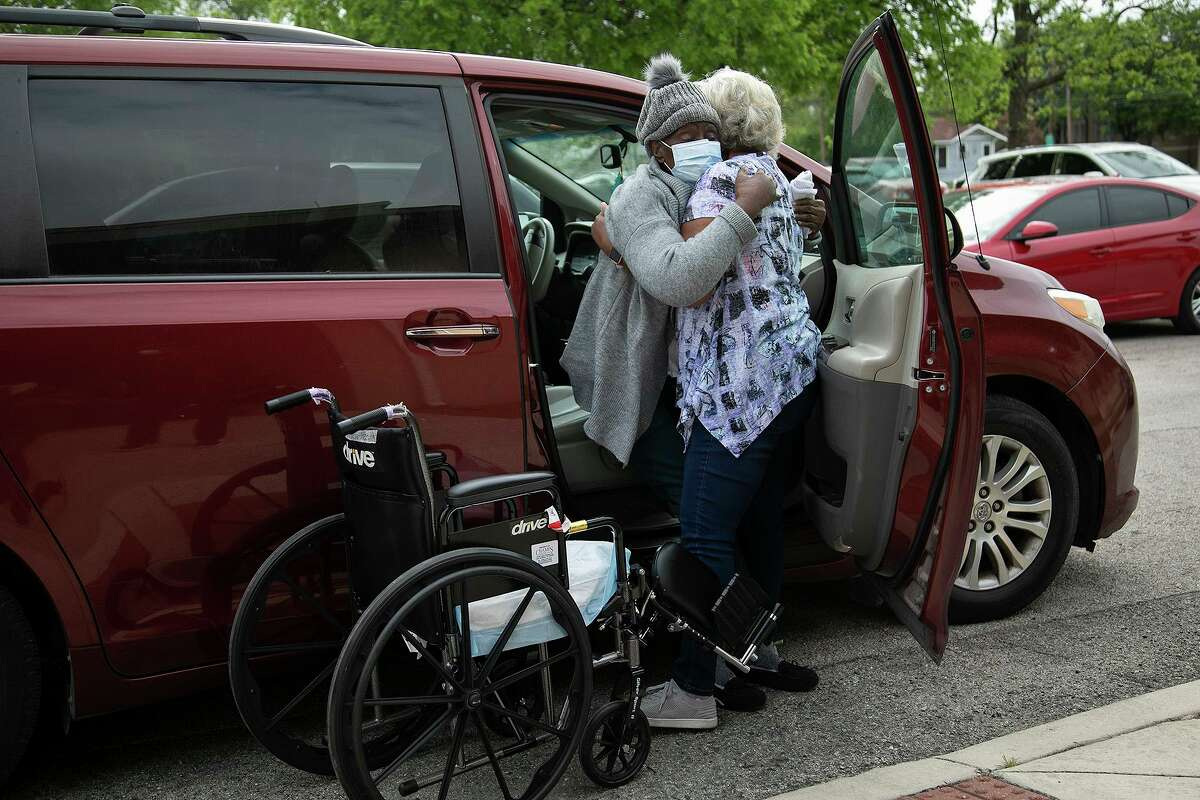 Eliza Bellesen helps her aunt, Rhoda Cubit, 87, out of the car and into her wheelchair for Cubit's appointment to get her second dose of the COVID-19 vaccine at Bethel AME Church in San Antonio on April 5, 2021. Bellesen has already had both doses.