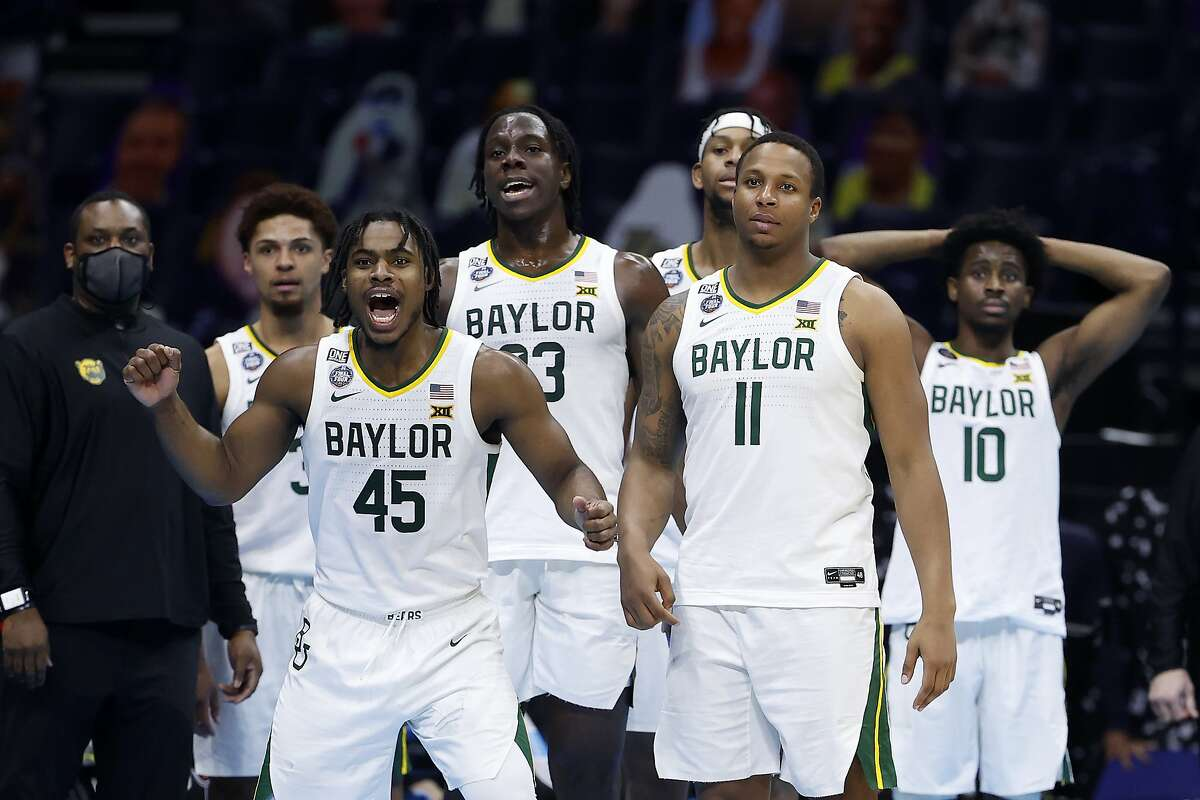 INDIANAPOLIS, INDIANA - APRIL 03: The Baylor Bears celebrate in the final minutes prior to defeating the Houston Cougars 78-59 in the 2021 NCAA Final Four semifinal to advance to the National Championship game at Lucas Oil Stadium on April 03, 2021 in Indianapolis, Indiana. (Photo by Jamie Squire/Getty Images)