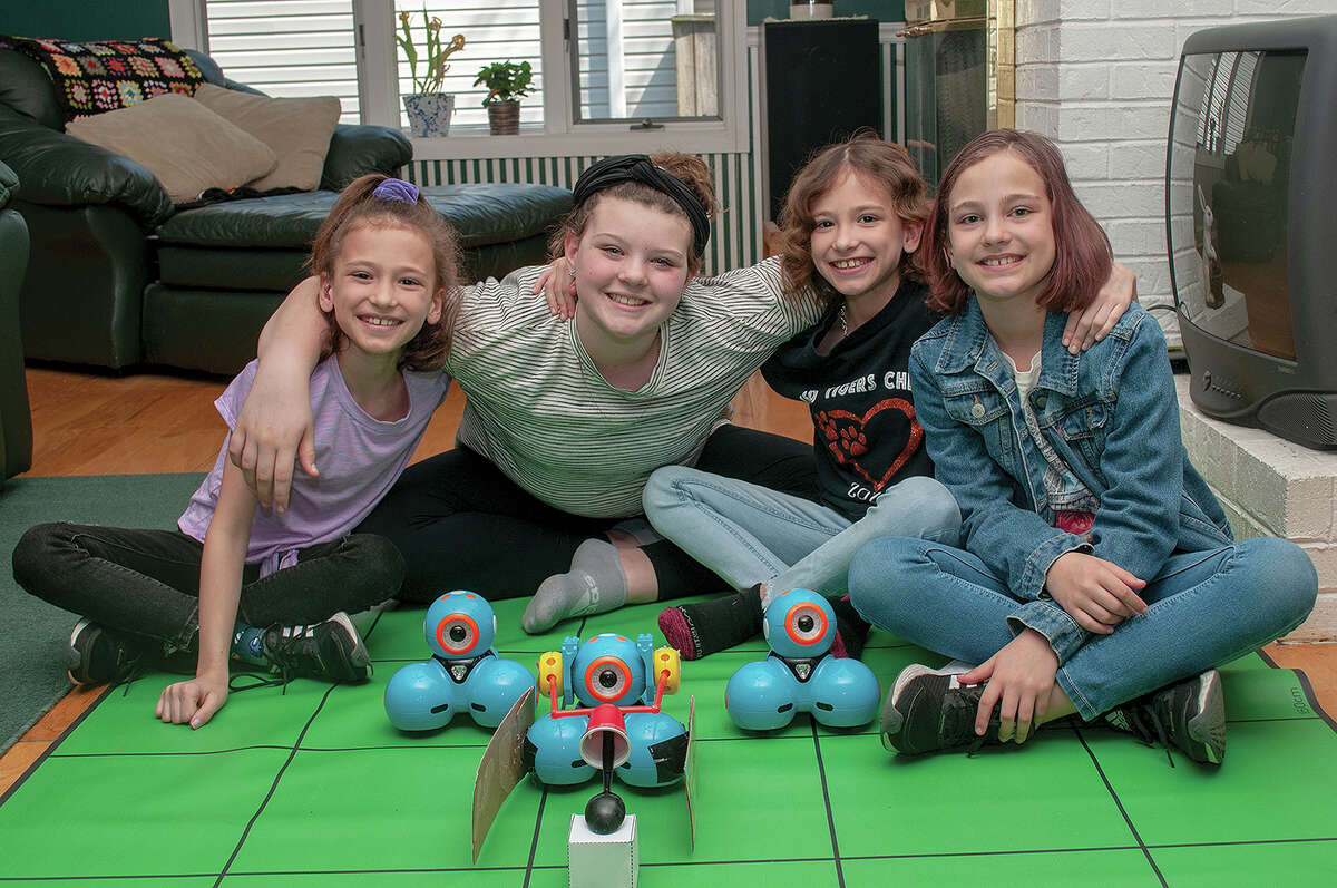 The team of Clodia Kuhn (from left), 9; Maci Lovekamp, 11; Covina Kuhn, 9; and Celine Kuhn, 9; placed in the top five out of 1,200 teams from 62 countries in a robotics competition.
