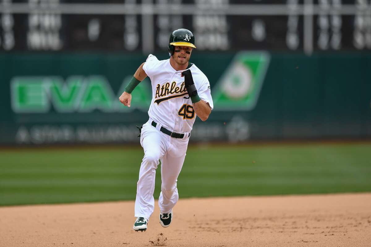 OAKLAND, CA - MAY 26: Oakland Athletics Outfield Skye Bolt (49) runs towards third base during the MLB game between the Seattle Mariners and Oakland Athletics on May 26, 2019 at the Oakland-Alameda County Coliseum in Oakland CA.(Photo by Stephen Hopson/Icon Sportswire via Getty Images)