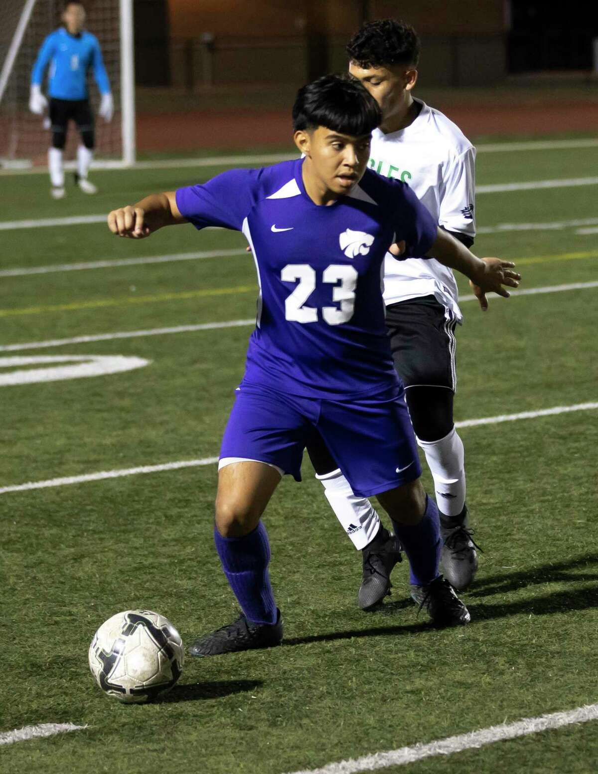 Humble midfielder Johan Ortega (23) drives the ball during the first half of a non-district soccer match against Pasadena at George Turner Stadium, Tuesday, Jan. 19, 2021, in Humble.