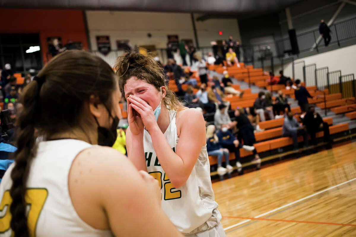 Dow's Kennedy Caldwell wipes tears from her eyes after the Chargers' state quarterfinal victory over Hartland Monday, April 5, 2021 at Flushing High School. (Katy Kildee/kkildee@mdn.net)