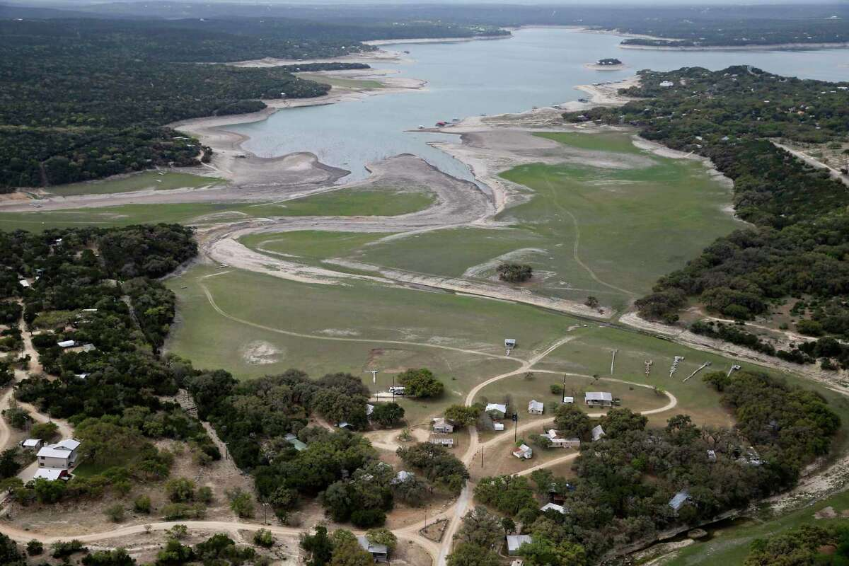 The effects of drought conditions were visible at Medina Lake in April 2021, before unseasonably wet weather came this summer. The Texas Water Development Board, however, said the recent reprieve won't last and that water conservation is still needed.