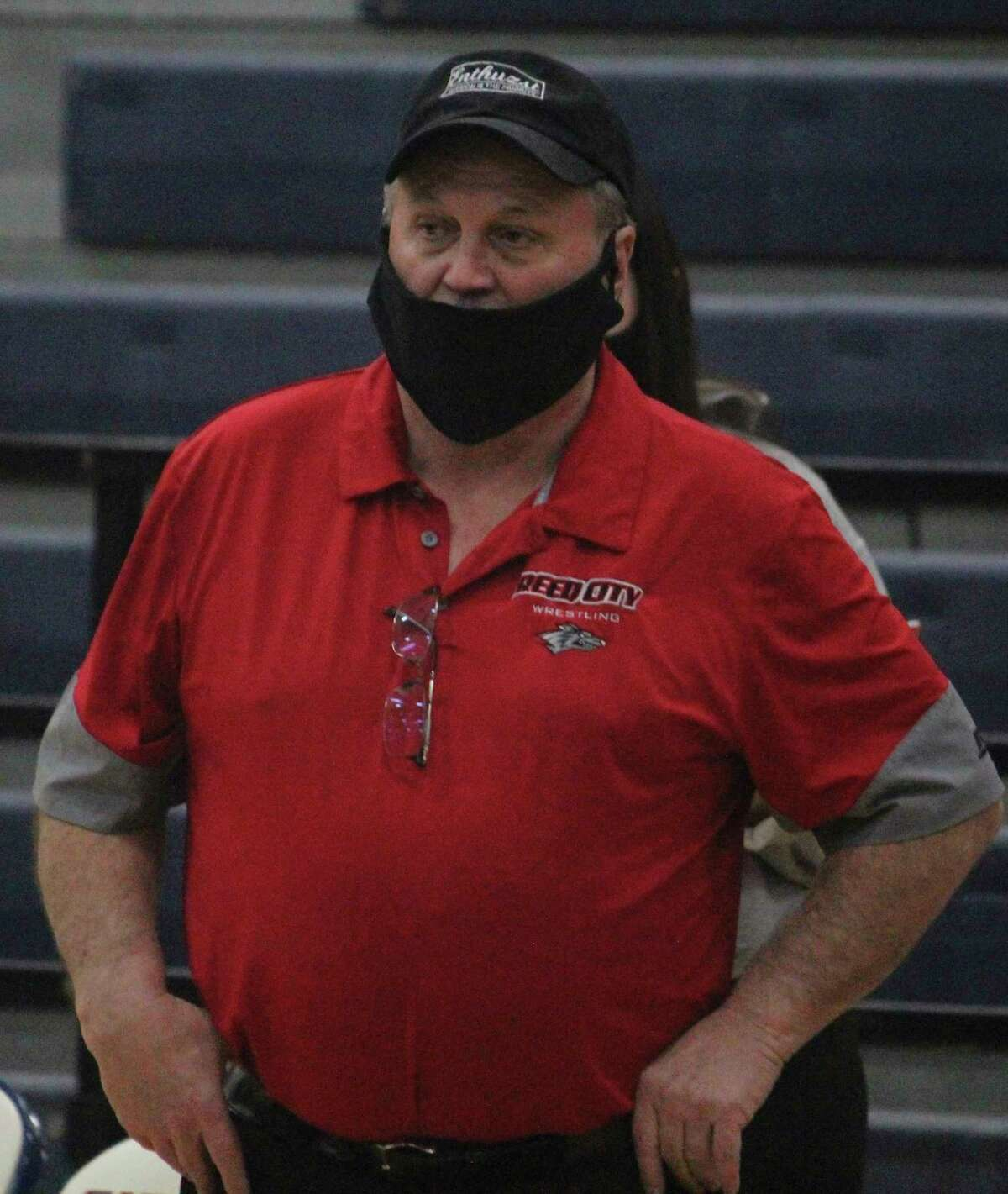 Reed City coach Roger Steig watches the action during a 2021 match. (Pioneer photo/John Raffel)