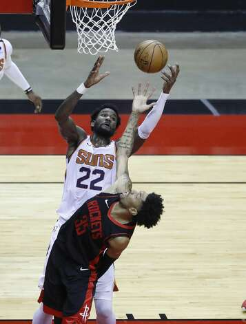 Phoenix Suns center Deandre Ayton (22) and Houston Rockets center Christian Wood (35) try to grab a rebound during the fourth quarter of an NBA basketball game at Toyota Center, Monday, April 5, 2021. Photo: Karen Warren/Staff Photographer / @2021 Houston Chronicle