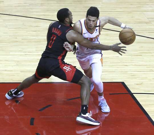 Phoenix Suns guard Devin Booker (1) works around Houston Rockets forward Sterling Brown (0) during the fourth quarter of an NBA basketball game at Toyota Center, Monday, April 5, 2021. Photo: Karen Warren/Staff Photographer / @2021 Houston Chronicle