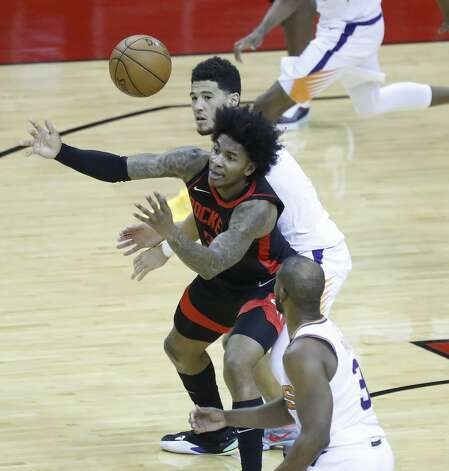 Houston Rockets guard Kevin Porter Jr. (3) tries to grab a loose ball against Phoenix Suns guard Devin Booker (1) during the third quarter of an NBA basketball game at Toyota Center, Monday, April 5, 2021. Photo: Karen Warren/Staff Photographer / @2021 Houston Chronicle
