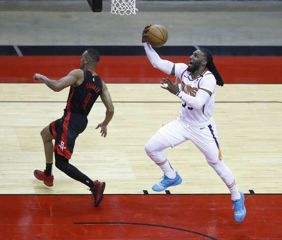 Phoenix Suns forward Jae Crowder (99) goes to the basket on a fast break during the fourth quarter of an NBA basketball game at Toyota Center, Monday, April 5, 2021. Photo: Karen Warren/Staff Photographer / @2021 Houston Chronicle