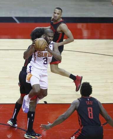 Phoenix Suns guard Chris Paul (3) passes the ball during the third quarter of an NBA basketball game at Toyota Center, Monday, April 5, 2021. Photo: Karen Warren/Staff Photographer / @2021 Houston Chronicle