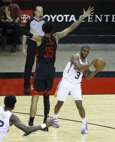 Phoenix Suns guard Chris Paul (3) passes the ball against Houston Rockets center Christian Wood (35) during the third quarter of an NBA basketball game at Toyota Center, Monday, April 5, 2021. Photo: Karen Warren/Staff Photographer / @2021 Houston Chronicle