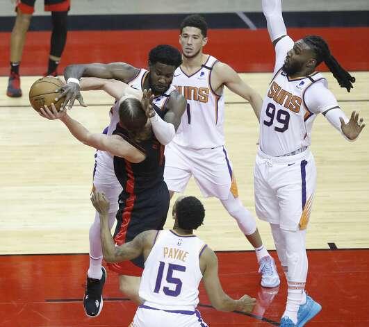 Phoenix Suns center Deandre Ayton (22) defends the basket against Houston Rockets forward Kelly Olynyk (41) during the second quarter of an NBA basketball game at Toyota Center, Monday, April 5, 2021. Photo: Karen Warren/Staff Photographer / @2021 Houston Chronicle