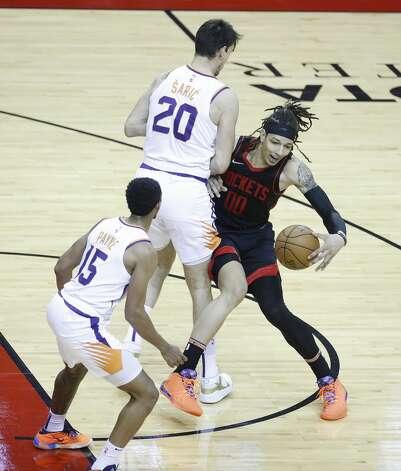 Houston Rockets forward D.J. Wilson (00) runs into Phoenix Suns forward Dario Saric (20) during the first half of an NBA basketball game at Toyota Center, Monday, April 5, 2021. Photo: Karen Warren/Staff Photographer / @2021 Houston Chronicle