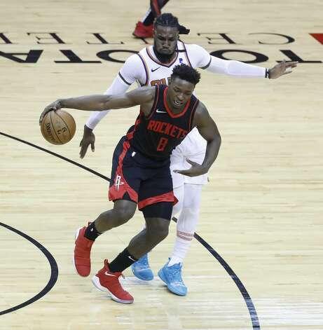 Houston Rockets forward Jae'Sean Tate (8) runs past Phoenix Suns forward Jae Crowder (99) during the third quarter of an NBA basketball game at Toyota Center, Monday, April 5, 2021. Photo: Karen Warren/Staff Photographer / @2021 Houston Chronicle