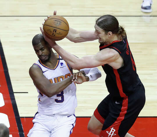 Houston Rockets forward Kelly Olynyk (41) runs into Phoenix Suns guard Chris Paul (3) trying to keep the ball inbound during the second quarter of an NBA basketball game at Toyota Center, Monday, April 5, 2021. Photo: Karen Warren/Staff Photographer / @2021 Houston Chronicle