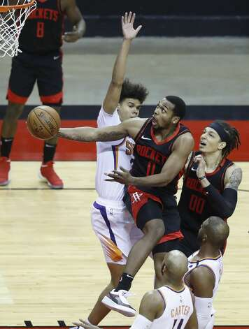 Houston Rockets forward Sterling Brown (0) goes up to the basket against Phoenix Suns forward Cameron Johnson (23) during the second quarter of an NBA basketball game at Toyota Center, Monday, April 5, 2021. Photo: Karen Warren/Staff Photographer / @2021 Houston Chronicle