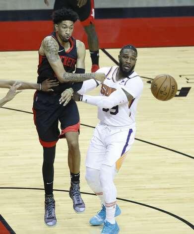 Houston Rockets center Christian Wood (35) passes the ball past Phoenix Suns forward Jae Crowder (99) during the first half of an NBA basketball game at Toyota Center, Monday, April 5, 2021. Photo: Karen Warren/Staff Photographer / @2021 Houston Chronicle