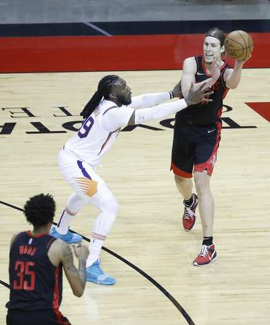 Houston Rockets forward Kelly Olynyk (41) passes the ball against Phoenix Suns forward Jae Crowder (99) during the first half of an NBA basketball game at Toyota Center, Monday, April 5, 2021. Photo: Karen Warren/Staff Photographer / @2021 Houston Chronicle