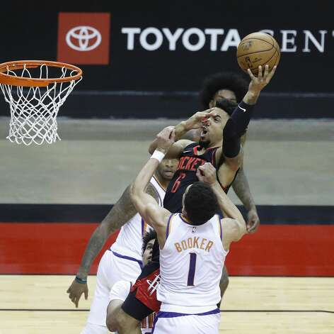 Houston Rockets forward Kenyon Martin Jr. (6) goes up the basket against Phoenix Suns guard Devin Booker (1) during the first half of an NBA basketball game at Toyota Center, Monday, April 5, 2021. Photo: Karen Warren/Staff Photographer / @2021 Houston Chronicle