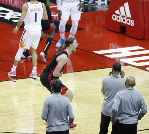 Houston Rockets forward Kelly Olynyk (41) reacts after his three-pointer during the fourth quarter of an NBA basketball game at Toyota Center, Monday, April 5, 2021. Photo: Karen Warren/Staff Photographer / @2021 Houston Chronicle