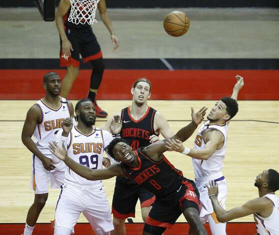 Houston Rockets forward Jae'Sean Tate (8) fights for a rebound against Phoenix Suns forward Jae Crowder (99) and Phoenix Suns guard Devin Booker (1) during the first half of an NBA basketball game at Toyota Center, Monday, April 5, 2021. Photo: Karen Warren/Staff Photographer / @2021 Houston Chronicle
