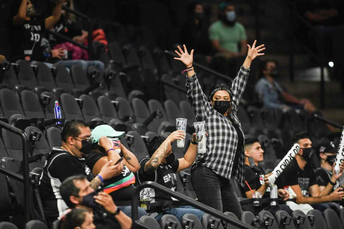 An enthusiastic fan dances during NBA action in the AT&T Center between the Spurs and the Cleveland Cavaliers on Monday, April 5, 2021.