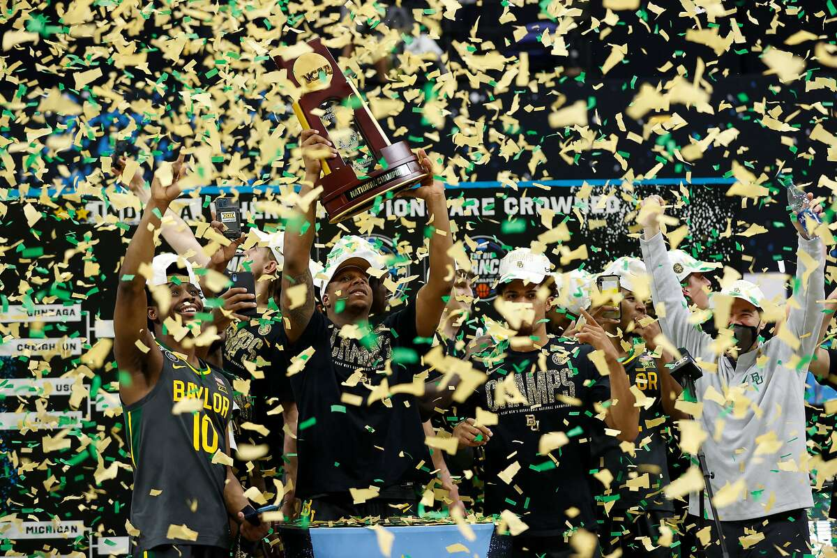Mark Vital #11 of the Baylor Bears holds up the trophy after defeating the Gonzaga Bulldogs 86-70 in the National Championship game of the 2021 NCAA Men's Basketball Tournament at Lucas Oil Stadium on April 05, 2021 in Indianapolis, Indiana.