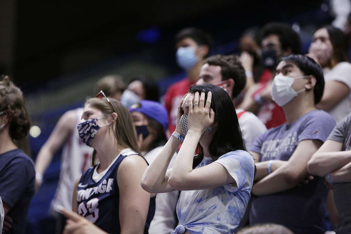 Gonzaga fans react while watching the final minutes of the NCAA Final Four college championship basketball game between Gonzaga and Baylor, which Baylor won, during a watch party at the McCarthey Athletic Center in Spokane, Wash., Monday, April 5, 2021.