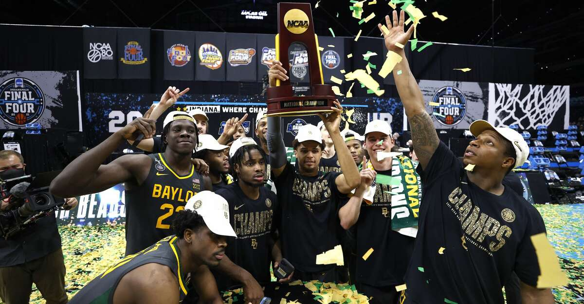 MaCio Teague #31 of the Baylor Bears holds up the trophy after defeating the Gonzaga Bulldogs 86-70 in the National Championship game of the 2021 NCAA Men's Basketball Tournament at Lucas Oil Stadium on April 05, 2021 in Indianapolis, Indiana. (Photo by Jamie Squire/Getty Images)