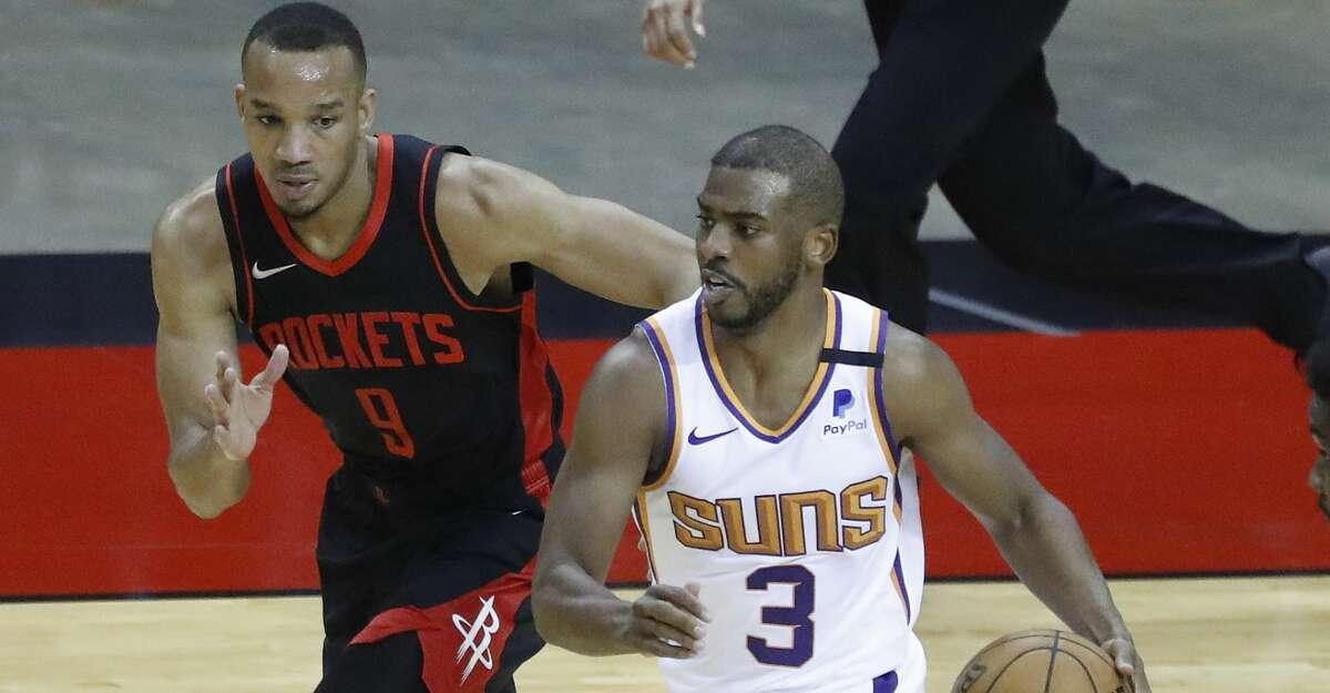 Phoenix Suns guard Chris Paul (3) runs the ball against Houston Rockets guard Avery Bradley (9) during the third quarter of an NBA basketball game at Toyota Center, Monday, April 5, 2021.