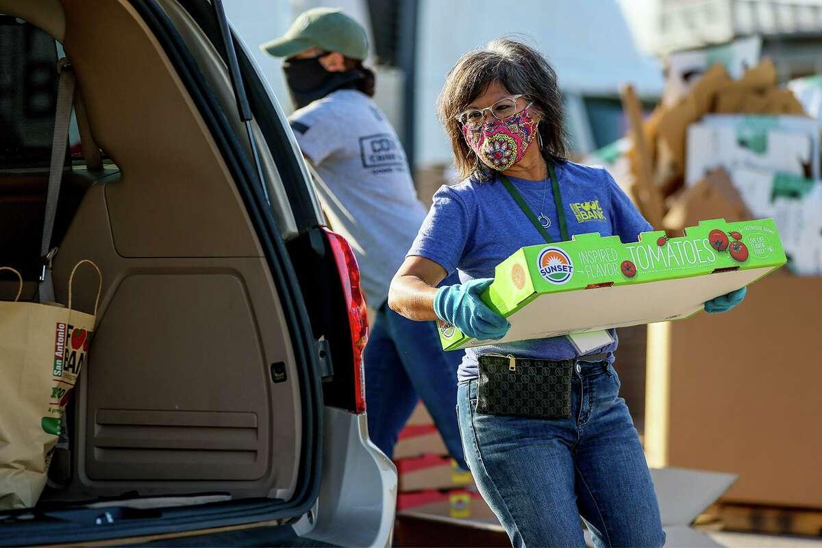 San Antonio Food Bank volunteer Yolanda Lopez helping at a mobile food distribution site. The Food Bank is in urgent need of volunteers this summer.