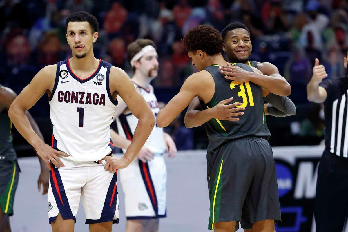 While Baylor's MaCio Teague (31) and Jared Butler enjoy the Bears' easy victory, Gonzaga players are left to contemplate their first loss of the season.