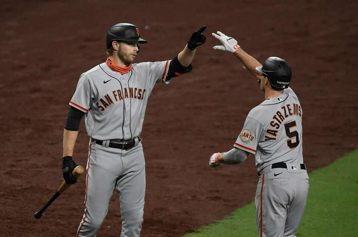 SAN DIEGO, CA - APRIL 5: Mike Yastrzemski #5 of the San Francisco Giants is congratulated by Austin Slater #13 after hitting a solo home run during the seventh inning of a baseball game against the San Diego Padres at Petco Park on April 5, 2021 in San Diego, California. (Photo by Denis Poroy/Getty Images)