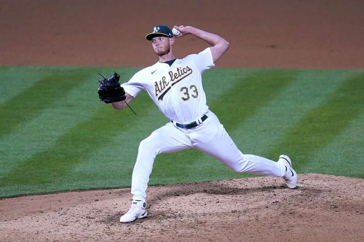 Oakland Athletics' A.J. Puk throws against the Los Angeles Dodgers during a baseball game in Oakland, Calif., Monday, April 5, 2021. (AP Photo/Jeff Chiu)