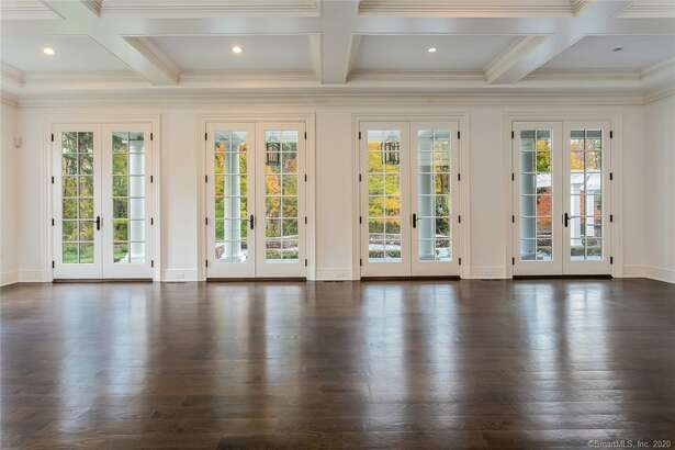 The 10,000-square-foot home built by Fotis Dulos on the private Jefferson Crossing road developed by his company has sold for $1.85 million.