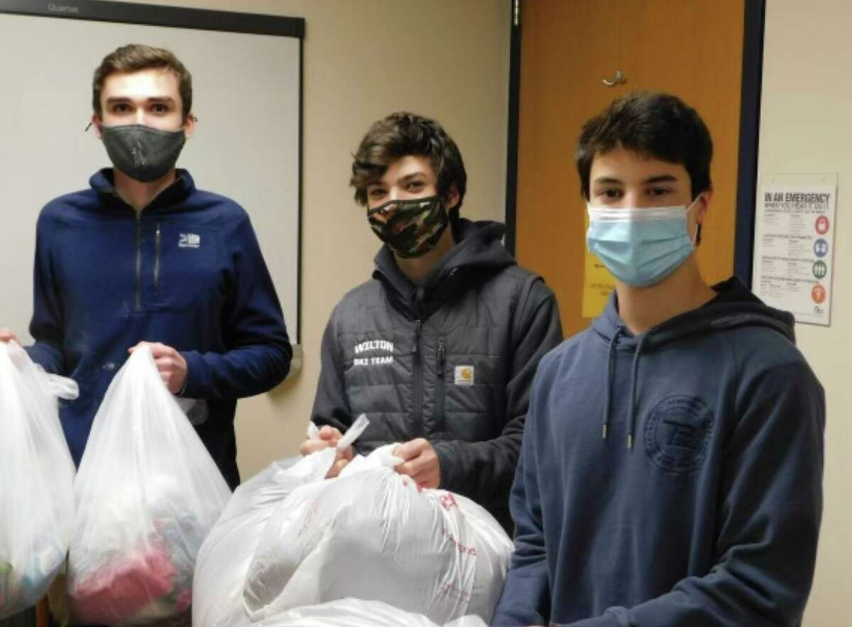 From left, senior Roenn Crameri, juniors Eli Ackerman and Tyler Casey are urging their school community to make one final push to donate as many socks as possible for veterans in the fourth and final Socks for Soldiers drive, ending April 14.