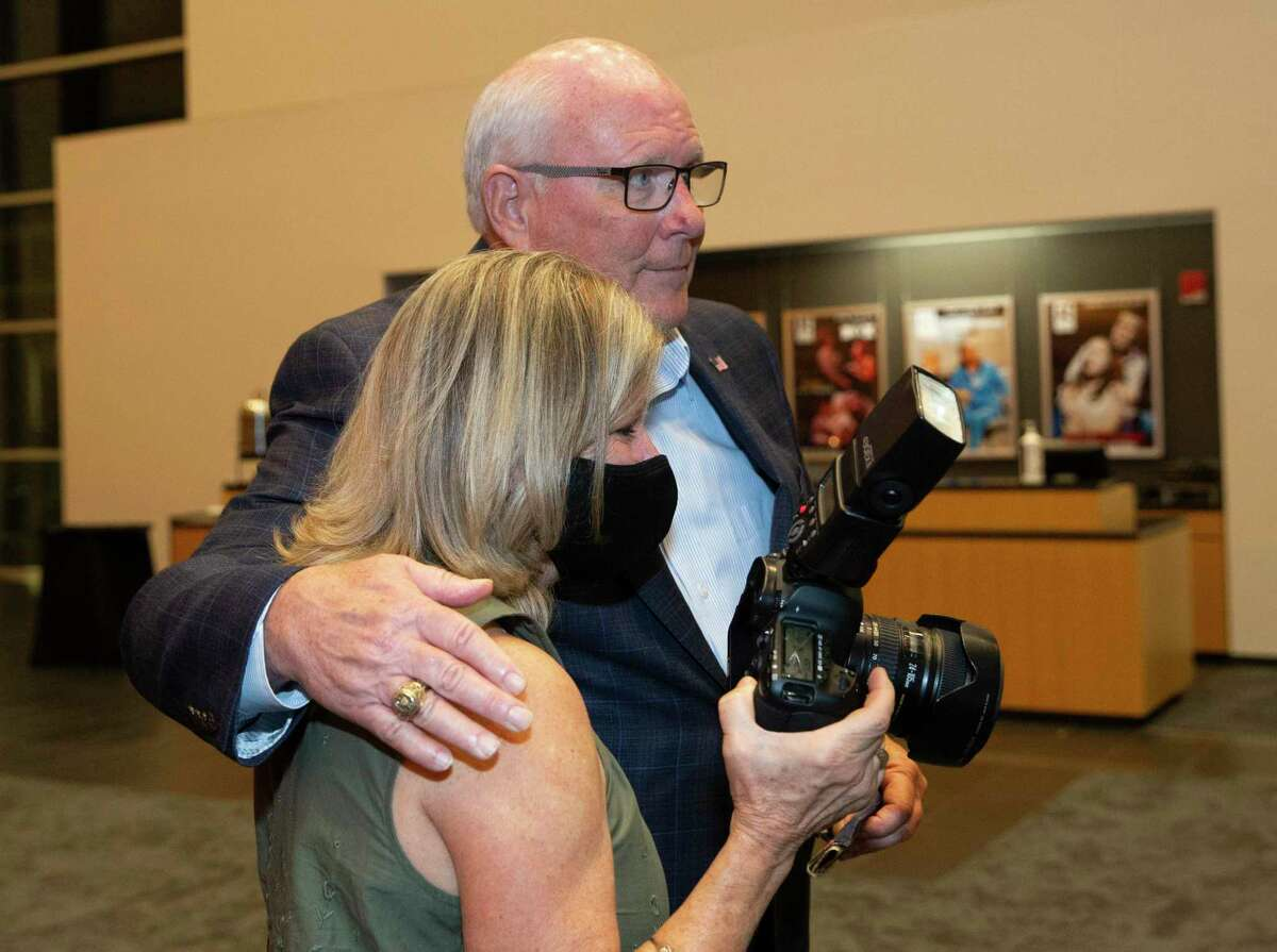 Harris County Precinct 3 Commissioner Candidate Tom Ramsey hugs his sister Deborah Williams after giving his winning speech Tuesday, Nov. 3, 2020, at AD Players at the George Theater in Houston.