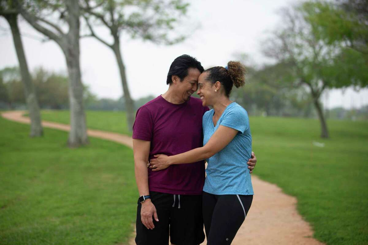 Active runner Ganesa and Quan Collins pose for a photograph on their usual running trail Saturday, March 27, 2021, at Independence Park in Pearland. Last July, the couple were on this route, when Quan, 50, blacked out and fell over with a cardiac arrest. Luckily, Ganesa, 48, was trained to perform CPR and ended up saving his life.
