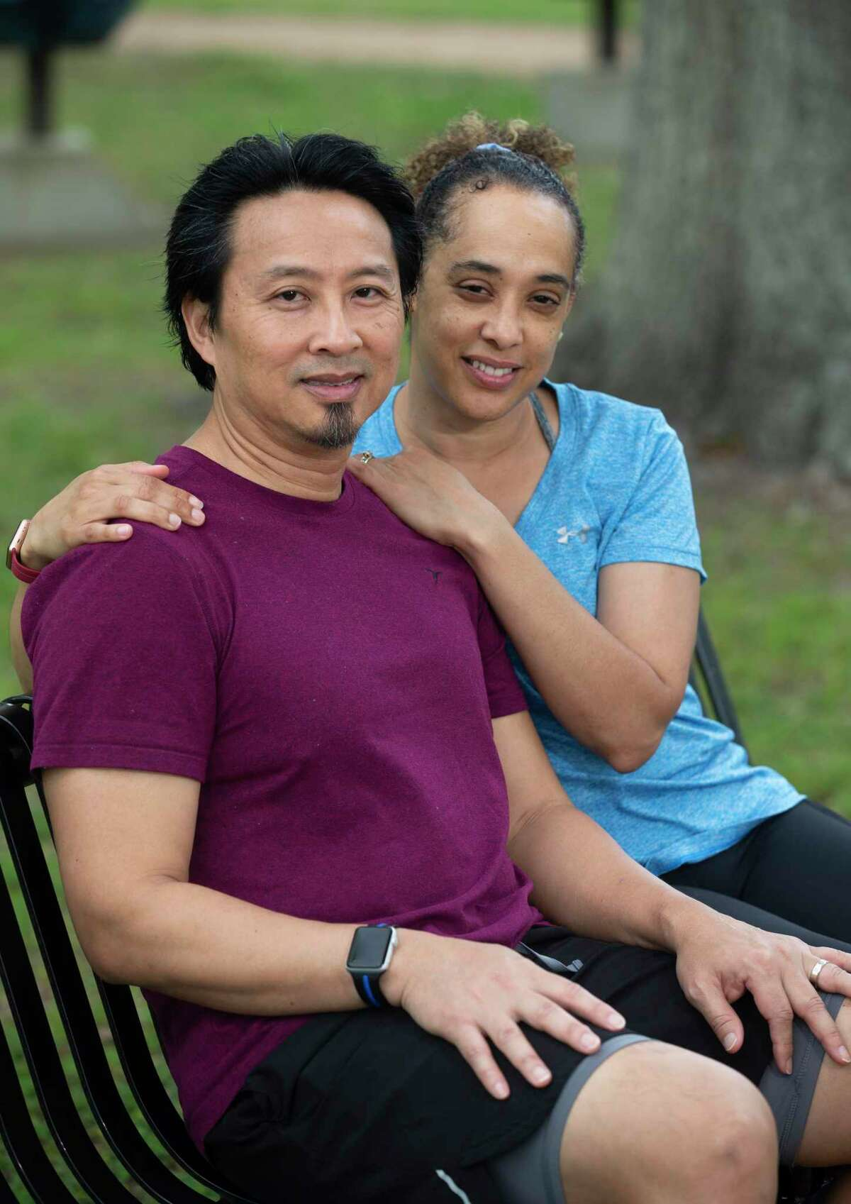 Active runner Ganesa and Quan Collins pose for a photograph on their usual running trail Saturday, March 27, 2021, at Independence Park in Pearland. Last July, the couple were on this route, when Quan, 50, blacked out and fell over with a cardiac arrest on this bench. Luckily, Ganesa, 48, was trained to perform CPR and ended up saving his life.