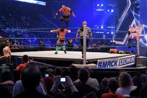 World Wrestling Entertainment (WWE) held its Smackdown event at Mohegan Sun in Uncasville, Conn. on Tuesday April 20, 2010. Here, WWE wrestler Kane, flies off the top rop into his opponent, CM Punk, during a tag team match.