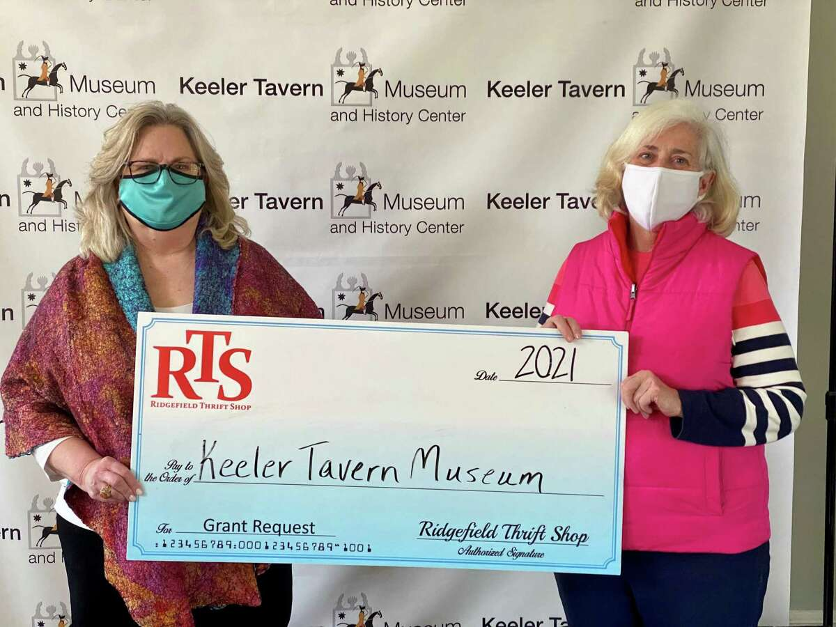 Keeler Tavern Museum & History Center Board President Rhonda Hill, left, recently accepted a grant from Ridgefield Thrift Shop volunteer Christine Nolan, right.