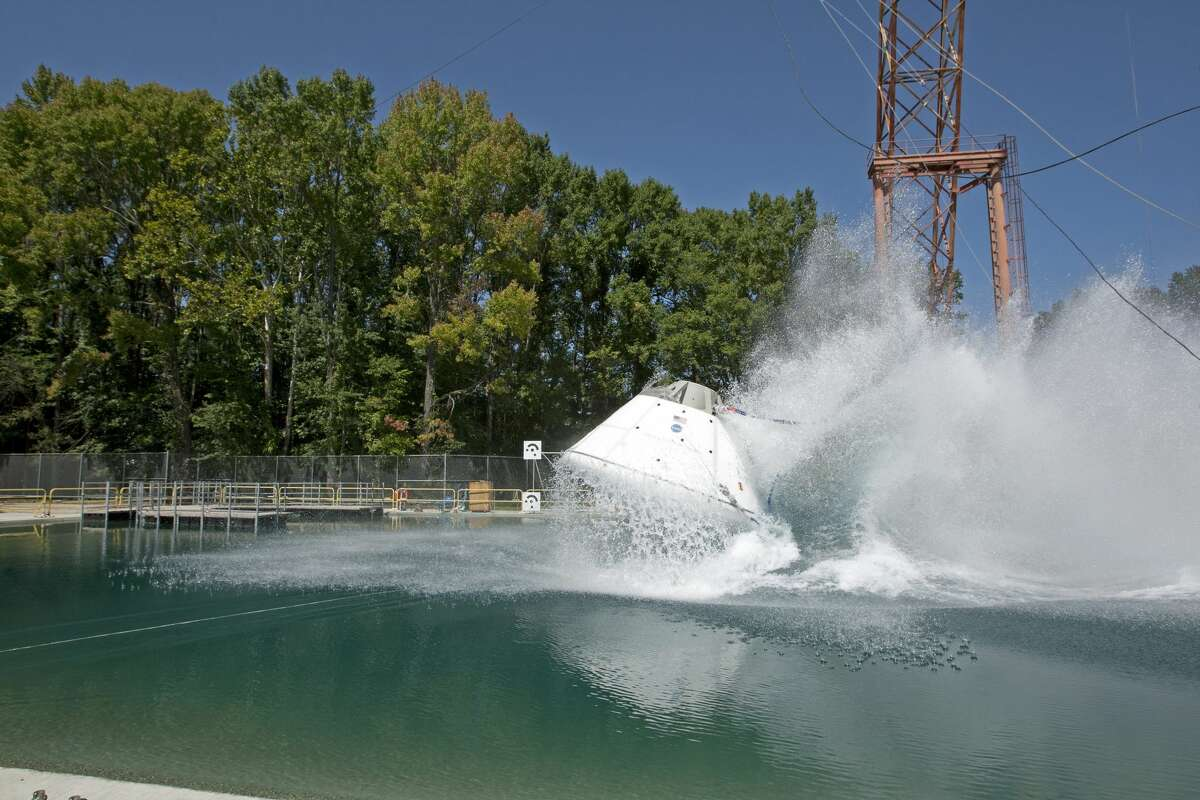 NASA plans to drop a test version of its Orion capsule into a water basin Tuesday at NASA's Langley Research Center in Hampton, Va. Pictured is a previous drop test of Orion.